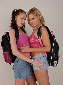 Blonde and Brunette Two School Girls Displaying Their Horny Activity