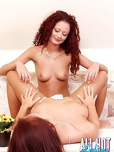 Two raven haired lesbian honeys licking and fingering their wet snatch