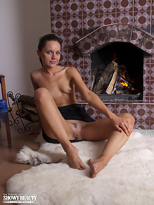 Brunette Lesbian Girl Sitting In A Horny Action On The Chair