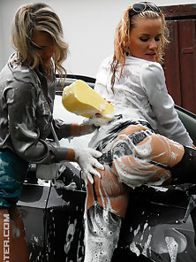 Busty Lesbians Having Pleasure While They Washing the Car