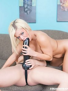 Busty Blonde Chick Making Riding Her Friend Strapon Dildo on the Couch