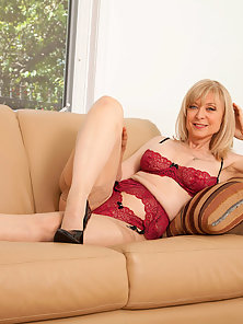 Dazzling MILF Nina Hartley Exposes Gorgeous Busty Figure on Couch