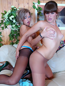 Cutes Gertie and Nora Rubs Each Other Boobs and Dildo Fuck in Doggy Action