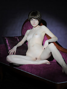 Lovable Nude Girl Gives Pose Wearing a Mask on the Couch