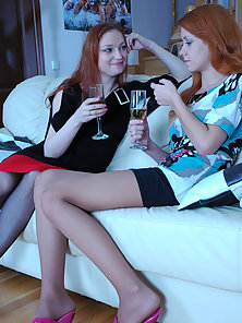Redhead Babes Rita and Salome Kissing and Rubbing Lovely Boobs on Couch