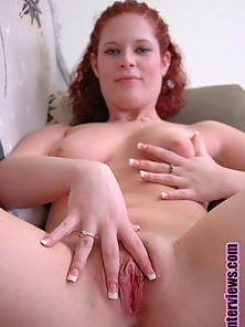 Red Headed Busty Babe Gives Horny Pose To Exposing Her