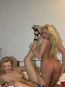 Blondes Angelica And Liz sharing a big blue dildo