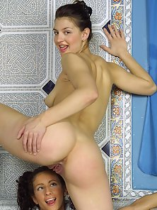 Dark-haired lesbo beauties getting kinky in the tub bath