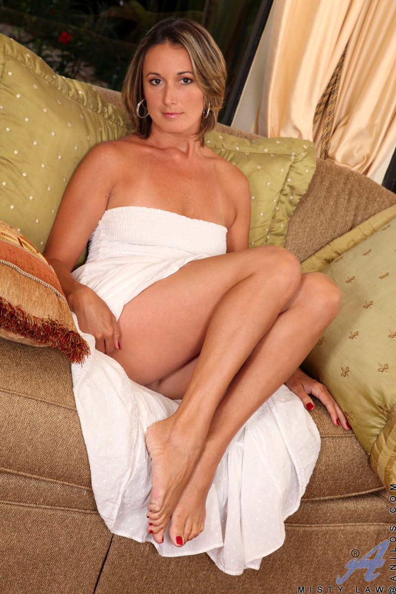 busty blonde whore sides her white dress and shows her sexy panty