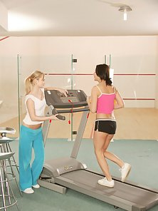Cute Brunette and Blonde Chick Getting Dildo Fuck In the Gym Centre