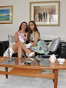 Brunette Busty Lesbians Licking and Fingering Their Cunts on Couch