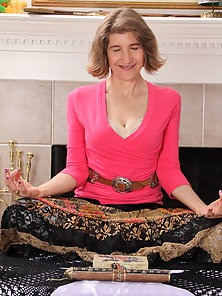 Naughty Granny Meditates before Pulling Up Her Skirt on Bed