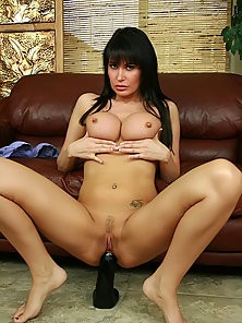Tattooed Brunette Babe Enjoys Twat Dildoing on Couch