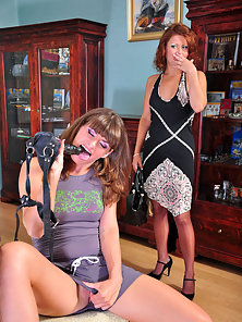 Various Poses of Lesbian Fun between Two Naughty Stylish Babes Megan and Gloria