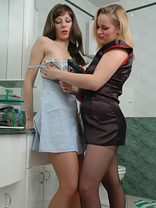 Antoinette and Susanna playing with their pantyhose