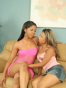 Hot Ebony Babes Riding a Big Fat Red Dildo on a Couch