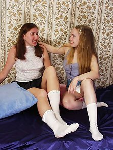 Two Naughty Lesbian Chicks Stripping and Licking Their Pussy on the Bed
