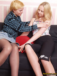 Two Blonde Lesbians Nolly and Ira Licking and Kissing On Sofa