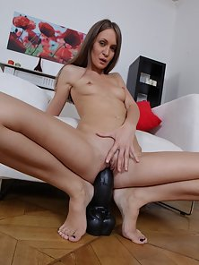 Sexy Nude Brunette Babe Miki Enjoying Riding Action by a Black Dildo