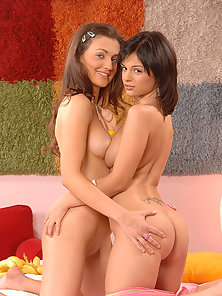 Pretty Brunette Girls Fucking Pussy by a Yellow Dildo on the Bed
