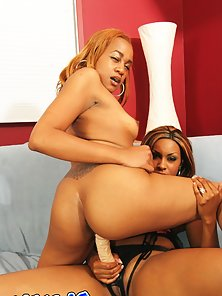 Sensual ebony sluts Kaleah and Tati giving each other a warm tongue ba