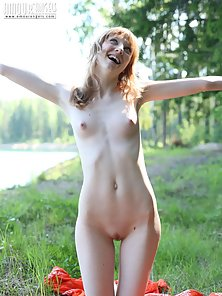 Redheaded girl with pale skin