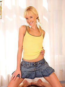 Horny Blonde Hanna with Yellow Top Posing Naughtily On Table