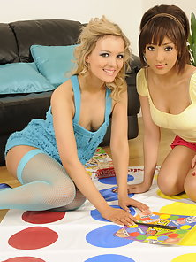 Cute lesbian babes playing naked games on the floor