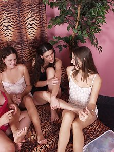 Horny lesbian threesome rubbing their clits