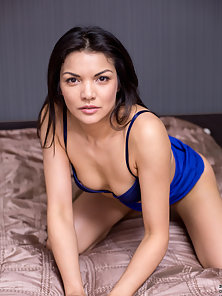 Asian beauty is stripping and happy to show off her naked figure