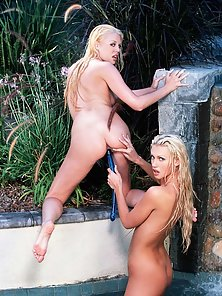Wet lesbians playing with dildos
