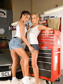 Two Skinny Pony tail Blonde and Brunette Chicks Rubbing Their Boobs in Car Showroom