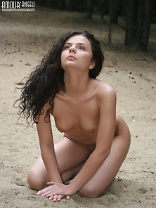 Sizzling Brunette Chick Nude Posing On the Sand in Crazy Manner