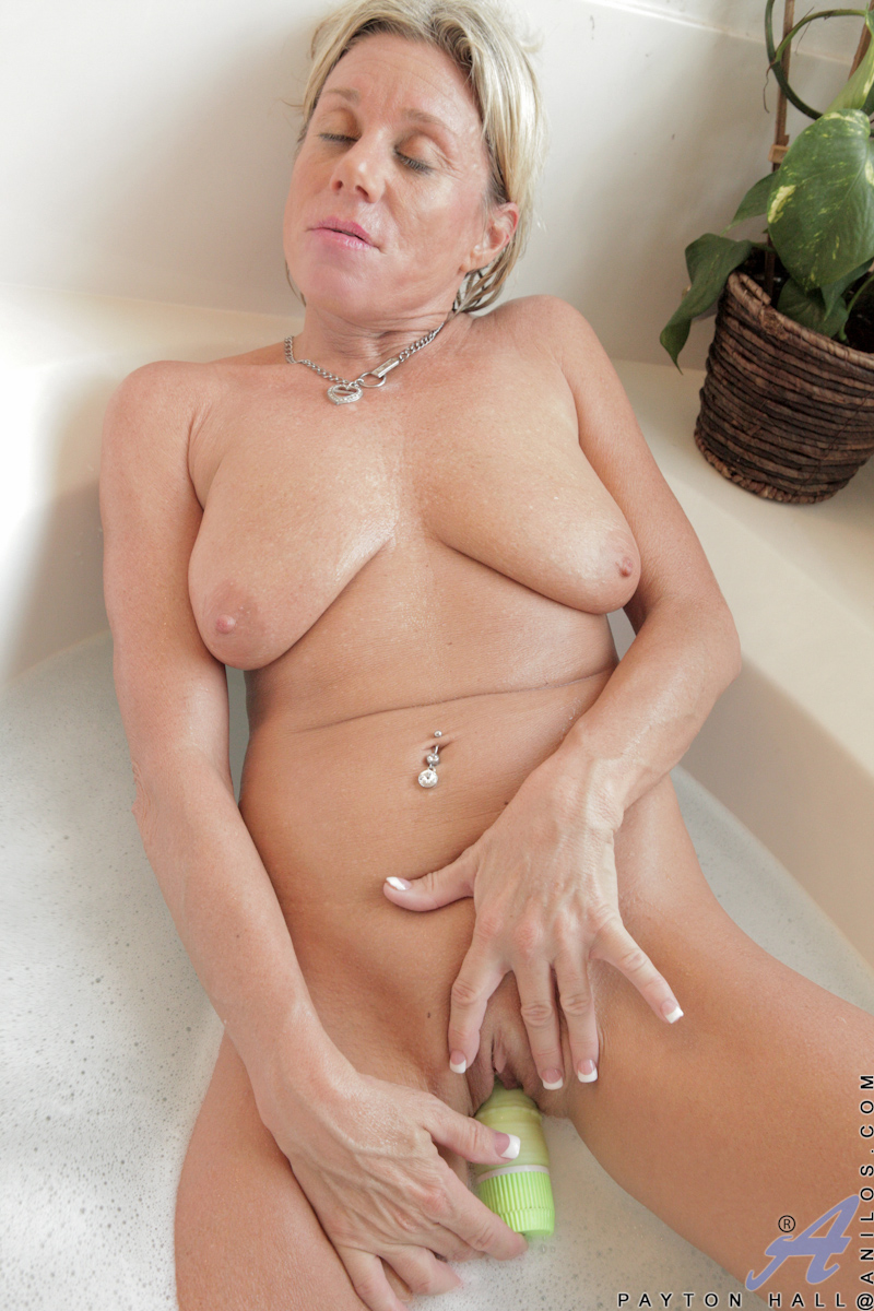 Mature masturbates in bathroom