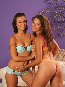 Hot Brunette Lesbians Showing Their Lovely Naked Bodies on a Couch