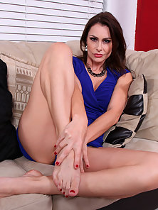 Appealing Brunette Lady Shows Her Sexiest Clad Figure on Couch