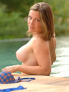 Busty Babe Gets Naked and Press Her Huge Soft Boobs in Lake