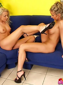 Free porn gallery picture Two over sexed blonde lesbians spreading and licking their petite pink poons on the couch