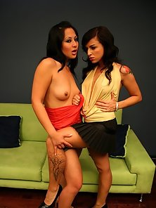 Horny brunette lesbians break out the toys for some nasty couch fuckin