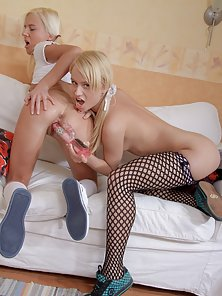 Two Petite Blonde Pigtail Chicks Exposing Their Boobs with Rubbing Action