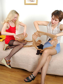 Two Teen Pantyhose Babes Alina and Sophia Enjoying Licking Action on the Couch