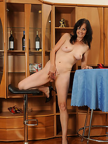 Dark Haired Classy Nilos Renie Shows Her Stretched Cunt with Huge Happiness
