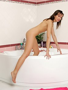 Avidat Strips Off Her Lacy Bikini and Enjoys Hot Dildo Action in the Bathroom