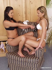 Two Hot Lesbians Kisses to Each Other Deeply on Couch in Naughty Mood