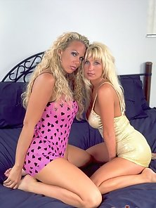Two Blonde Buxom Lesbians Fucking Hard By Riding a Double Headed Dildo