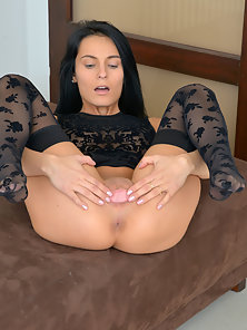 Gorgeous brunette Lexi Dona opens her wet pussy