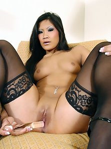 Exotic Asian nymph wearing stockings and rubbing one out