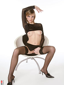 Black Dress Stocking Girl Displaying Her Natural Tits on the Chair