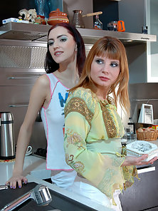 Alice and Irene and Judith Fucking With Strapon Dildo in Kitchen
