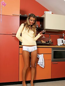 Gorgeous Pretty Babe Klara Loves To Display Her Nude Body in the Kitchen